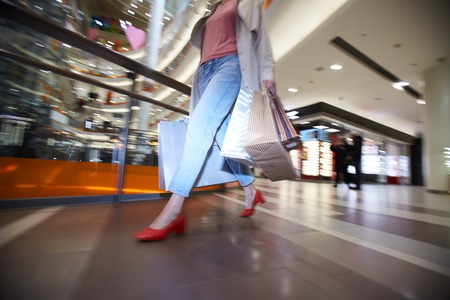 Woman hurrying to buy clothing on sale 写真素材