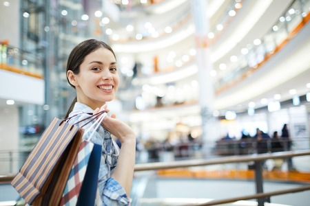 Positive girl with purchases