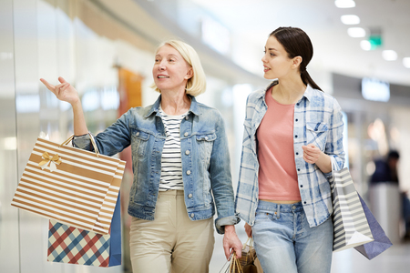 Blond lady recommending clothing store to daughter