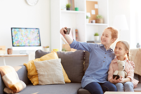 Two Sisters Taking Selfie at Home