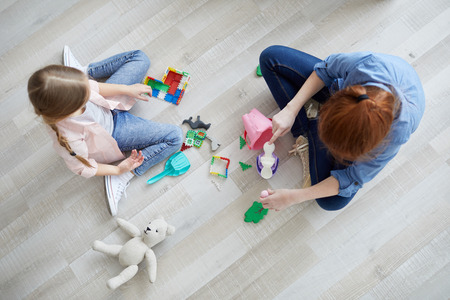 Two Girls Playing Top View Stock Photo - 119631595