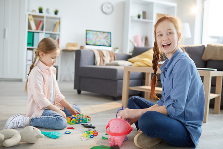 Two Sisters Playing at Home Stock Photo - 119631744