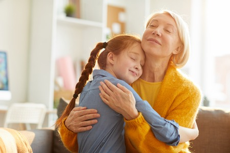 Mother and Daughter Embracing Tenderly Stock Photo