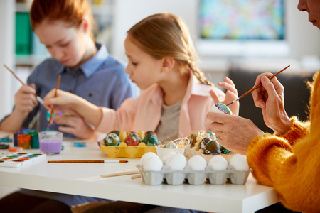 Family Painting Eggs for Easter Stock Photo - 119632156