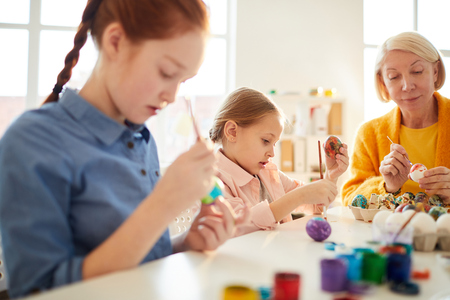 Kids Painting Eggs for Easter