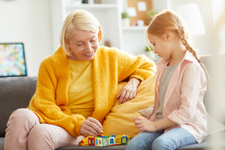 Mature Woman Playing with Girl Stock Photo