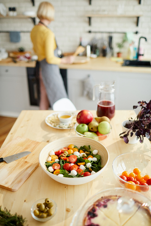 Appetizing vegetable salad on dining table