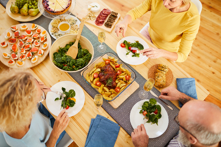 Enjoying delicious dinner with friends Stock Photo