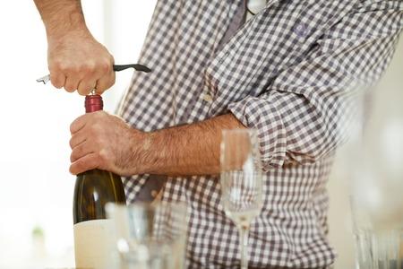 Drawing cork from wine bottle Reklamní fotografie - 119823062