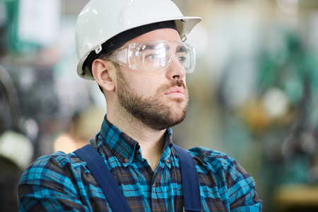 Pensive Factory Worker Stock Photo