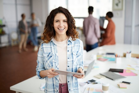 Creative Woman Smiling in Office