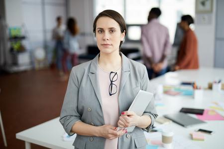 Successful Businesswoman Posing in Office