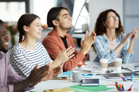 Young People Clapping for Presentation Stock Photo