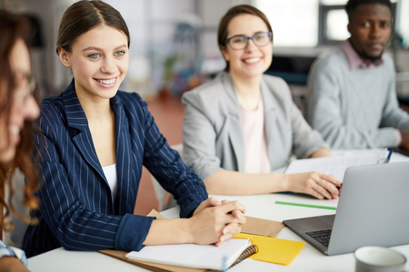 Young Businesswoman at Meeting Table