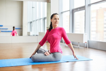 Twisting body while practicing yoga
