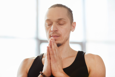 Serene man practicing meditation