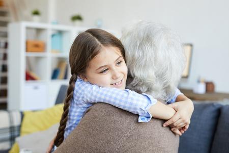 Little Girl Embracing Grandmother Banco de Imagens