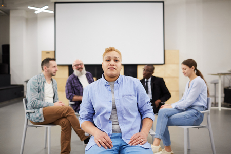Woman Posing in Group Therapy