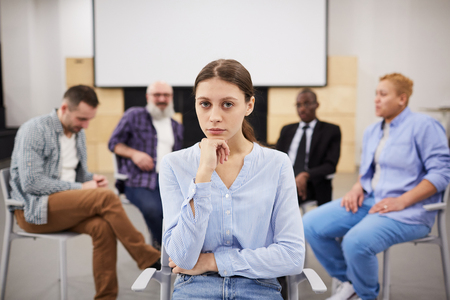 Young Woman in Group Therapy Stock Photo