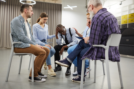 African-American Man in Support Group Stock Photo