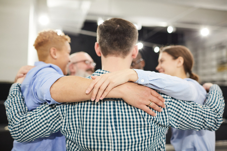 Group Hug in Therapy Session Imagens