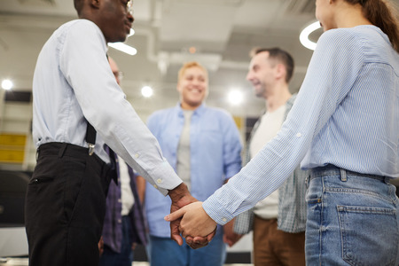 People Holding Hands in Circle Stock Photo