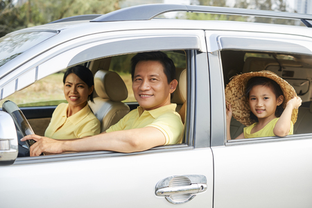 Cheerful family riding in car
