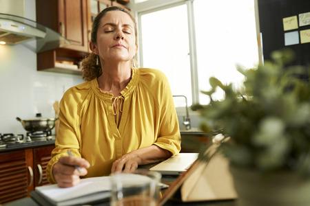 Woman pondering over idea Banco de Imagens