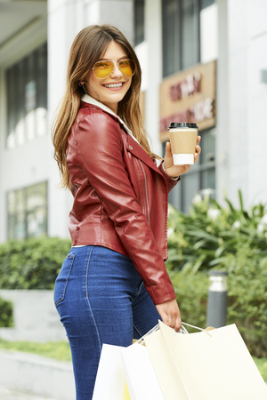 Pretty woman with coffee and paper-bags