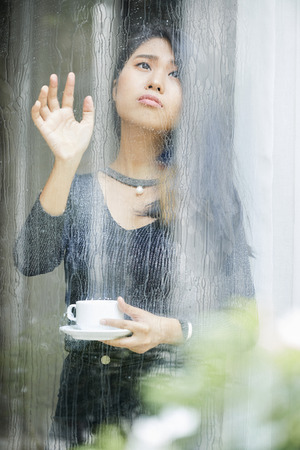 Melancholic woman is not happy with rainy day