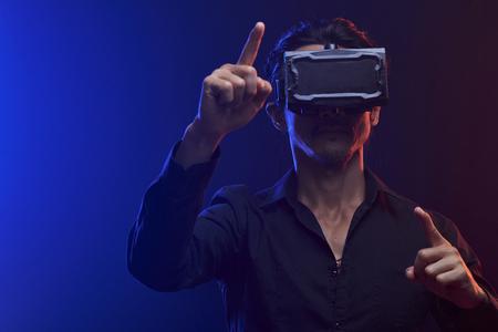 Man having fun in virtual reality Stock Photo