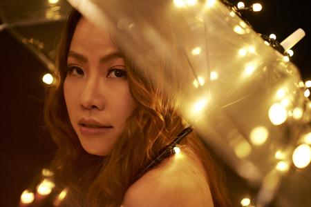 Woman posing with sparkling umbrella 写真素材