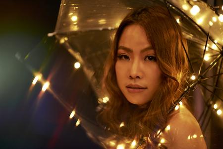 Fashion model with sparkling umbrella