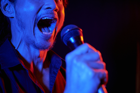 Man singing to microphone