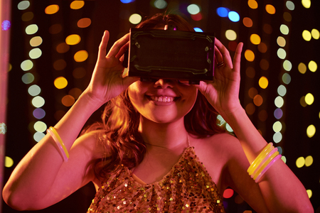 Young woman in virtual reality glasses