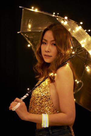 Asian woman with sparkling umbrella Stock Photo