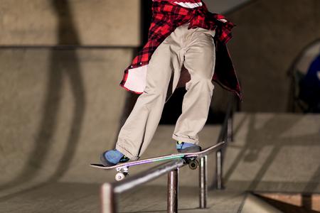 Skater Sliding on Rail Foto de archivo - 120428609