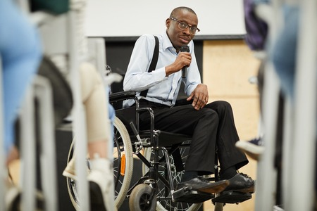 Disabled motivational speaker at conference
