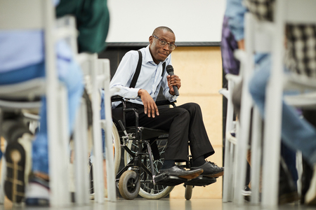 Successful disabled black scientist addressing conference