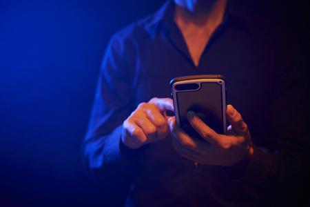 Man using mobile phone Stockfoto