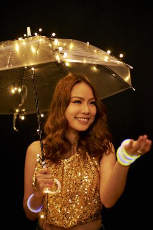 Young woman under umbrella
