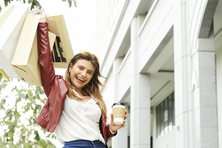Cheerful young woman after shopping