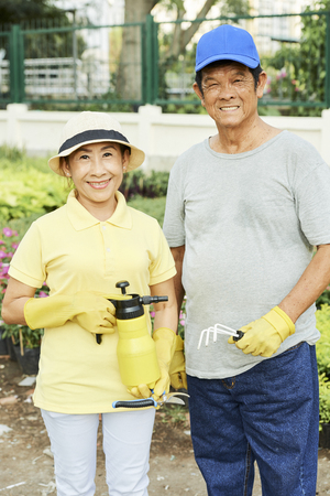 Husband and wife with gardening tools