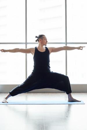 Yogis doing balance exercise Imagens