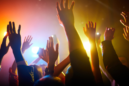 Waving hands in air during performance of musician