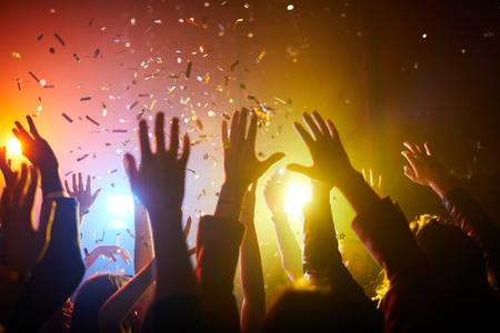 Raising hands up at musical performance Reklamní fotografie