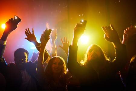 Group of fans enjoying performance of musician