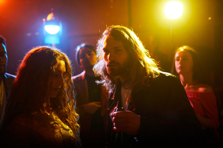 Long-haired guy at party