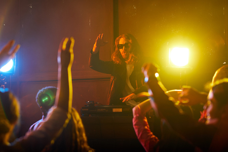 DJ rocking crowd