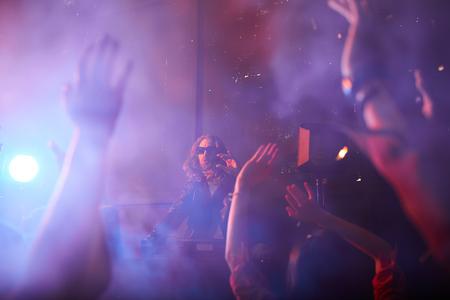 Popular dj playing at party Standard-Bild - 120890277